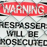 how to deal with trespassing neighbors